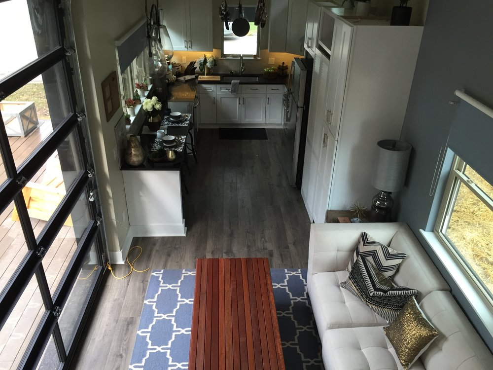 The kitchen is HUGE! Way bigger than kitchens in a NYC apartment. Black countertops, beautiful white tile.