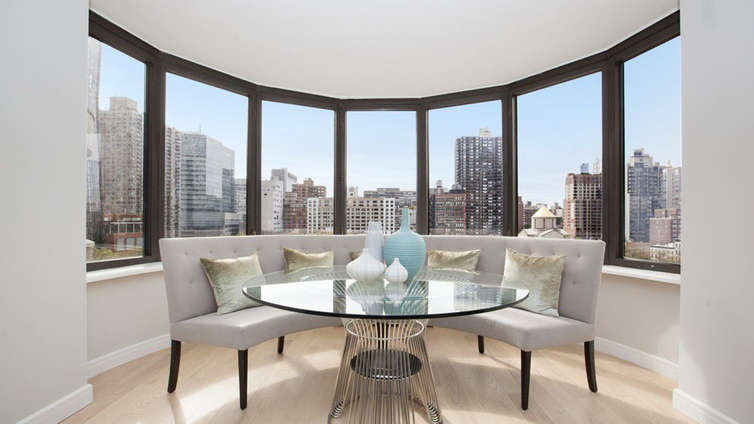 Housed in the historic Murray Hill neighborhood, Corinthian Collection offers 1, 2, and 3 bedroom residences starting from $925K. The residences are stylish and luxurious, encouraging a remarkably convenient lifestyle. Andres Escobar's breathtaking take on the interior exhibits oversized bay windows looking over the bustling surroundings, commendable finishes, a palette of soft, soothing shades, and usage of natural woods.    The expansive balconies are airy and provide the residents just the right amount of personal space and time. Along with a range of premium museums, malls, and parks, the neighborhood houses Fairway Market, New York Public Library, and Grand Central. Amenities include a fitness center and spa, fitness and yoga classes, outdoor jogging track, sun deck, and a 24-hour doorman.     CITY REALTY ARTICLE     The Corinthian at 330 East 38th Street is distinctive and occupies an entire block. Built on the former East Side Airlines site and completed in 1988, it has a distinctive shape of bundled cylinders and offers city and river views.    The Corinthian contains 865 units on 54 residential floors that feature hardwood floors and such architectural details as large columns and curved walls. French doors open on to rooms that can be used as libraries or dens. Kitchens have granite countertops and units are equipped with walk-in closets, spacious galleries, washers and dryers and manywindows. Every apartment – with the exception of studios – has a balcony, and some of the larger residences have more than one. Many apartments have been updated to include state-of-the-art appliances.    The Corinthian's amenities include a full-service health club with a glass-enclosed pool, sauna, steam room, Jacuzzi, outdoor jogging track and a sun deck. There is also a full-time doorman and concierge, valet service and a garage. Located in Murray Hill, the building is situated close to the East River and the Midtown business district.    CONTACT US FOR MORE INFORMATION A