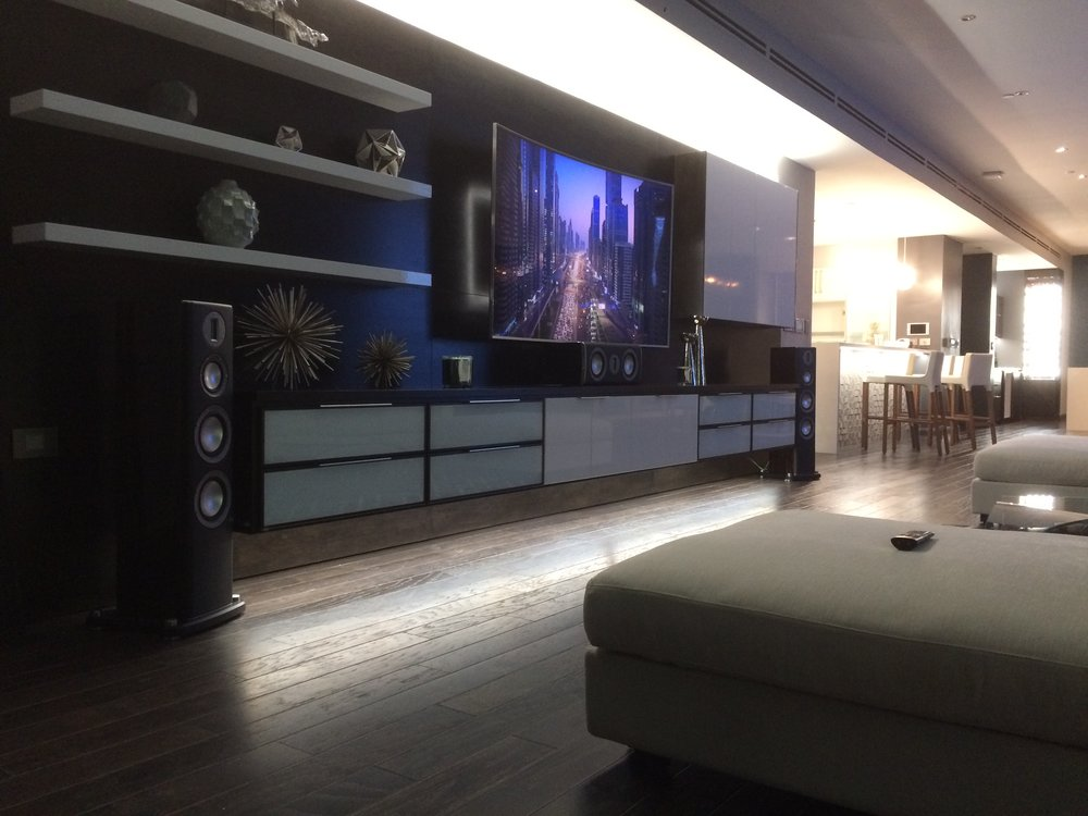 At Night this modern family room comes alive with led accent lighting and the sound of its Monitor Audio Platinum Series Home Theatre