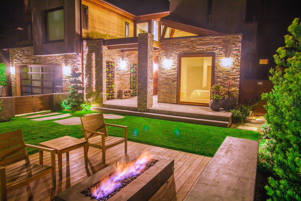One of the outdoor spaces with gas fire pit and a relaxing Capitola vibe