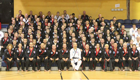 Grandmaster Hee Il Cho, AIMAA Founder & President with AIMAA Black Belts, Europe.