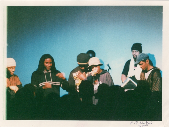 L-R: Jonathan Moore, Rajnii, Kendu (of Black Anger), Gabriel Teodros, DJ Pryme Tyme, Castro (of 500 Years). Photo by Michelle Mukai, taken at an Aceyalone & Abstract Rude show in Seattle, 2000.