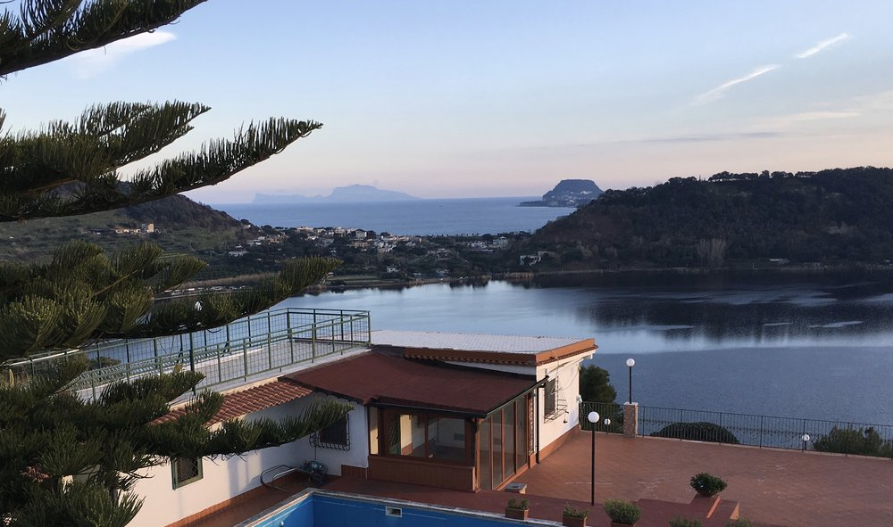 The view is of a protected lake plus the sea and the island of Capri in the far background.