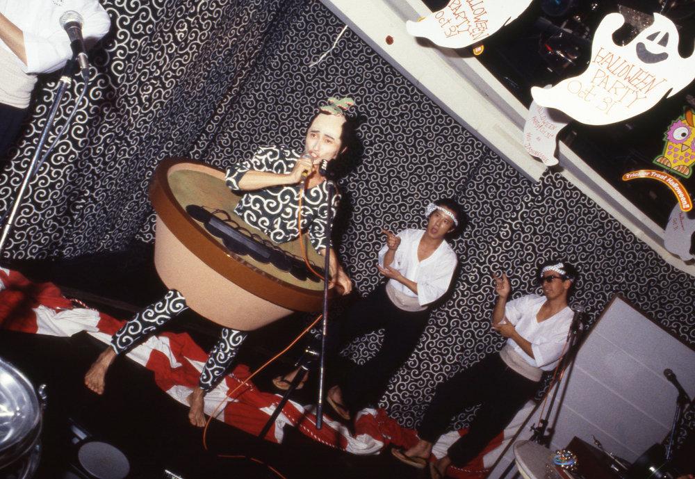 "Numata Genqui performing as the ""Bonsai Kozoh,"" Roppongi, Tokyo, ca. 1986"