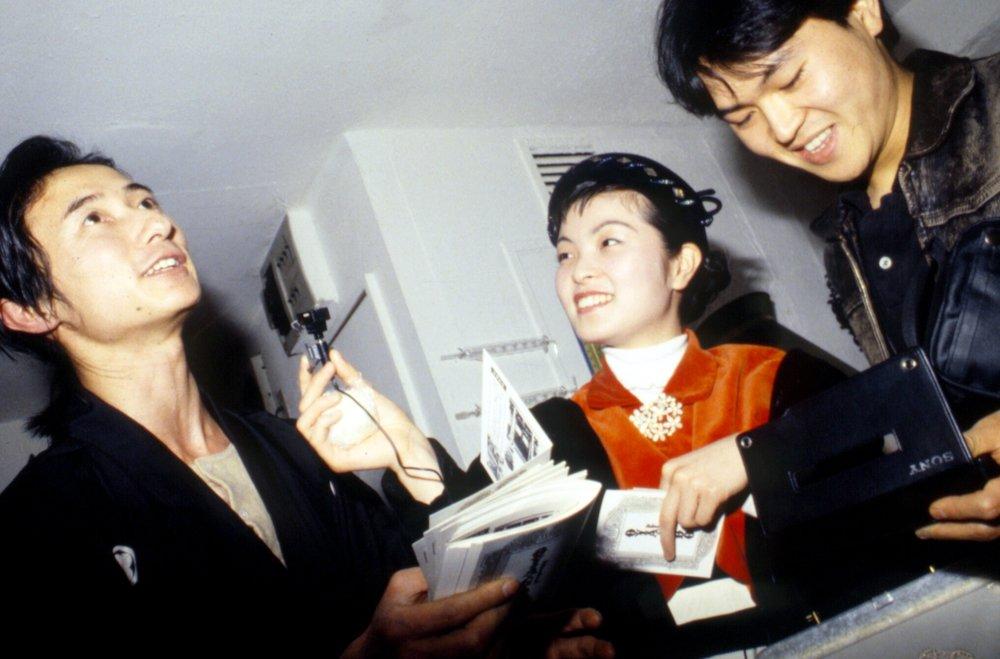 Numata Genqui (left) interviewed at gallery reception, Tokyo ca. 1988
