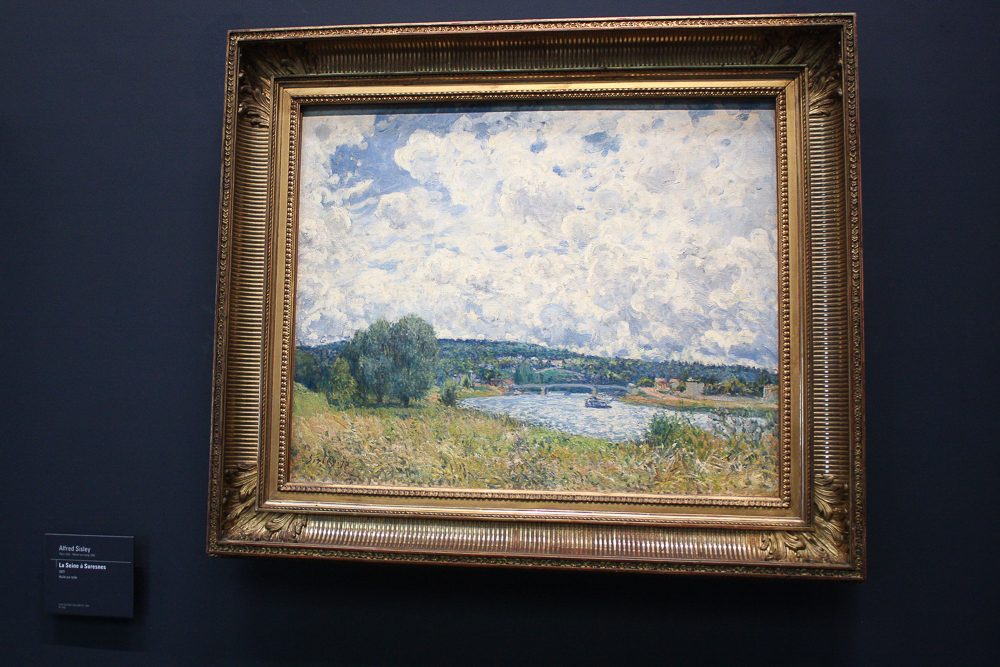 Alfred Sisley's La Seine à Suresnes. Look at those clouds!