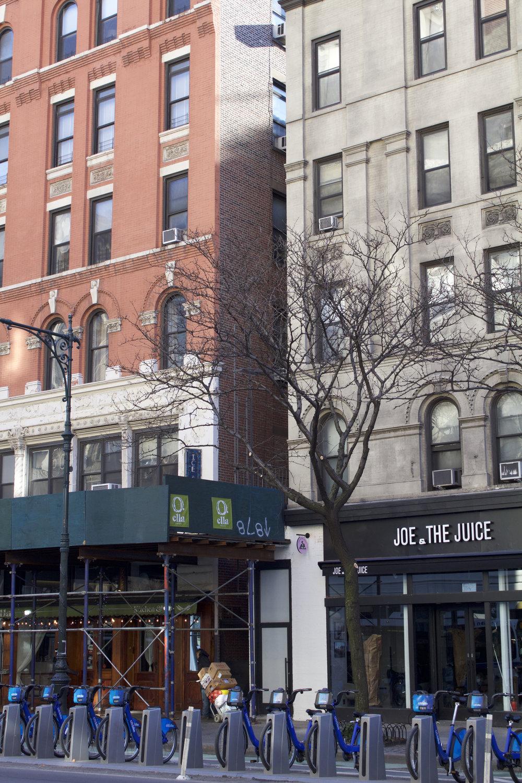 Scaffolding, Citibank bicycles, and an international juice bar chain capture the neighborhood's zeitgeist.