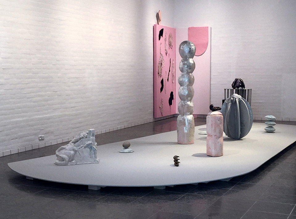 Totemic fruits (Psyche) jesmonite, pigments, glazed porcelain, silver leaf, plywood, concrete, swans egg, stainless steel, textile, silicone, plaster, morph-suit, chameleon paint, spray paint, video-loop, dimensions variable 2016