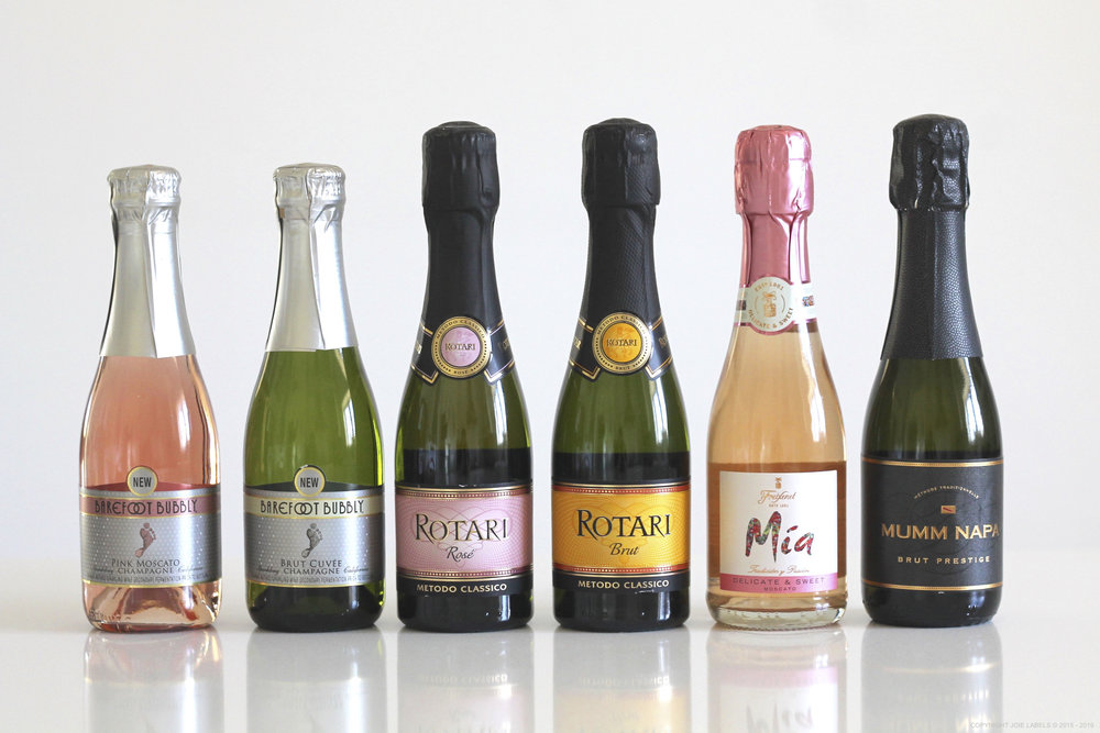 From left TO RIGHT:  Barefoot Bubbly Rosé, Barefoot Bubbly Cuvée, Rotari Rosé, Rotari Brut, Mia Sparkling Moscato, Mumm Napa Brut Prestige.