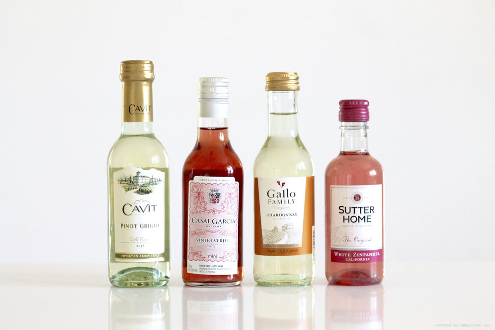 FROM LEFT TO RIGHT:   Cavit Pinot Grigio, Casal Garcia Vinho Verde, Gallo Chardonnay, Sutter Home White Zinfandel