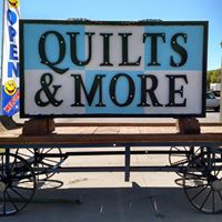 Quilts and More - A fabric store with more. Quilting fabric and notions, antiques and pottery.