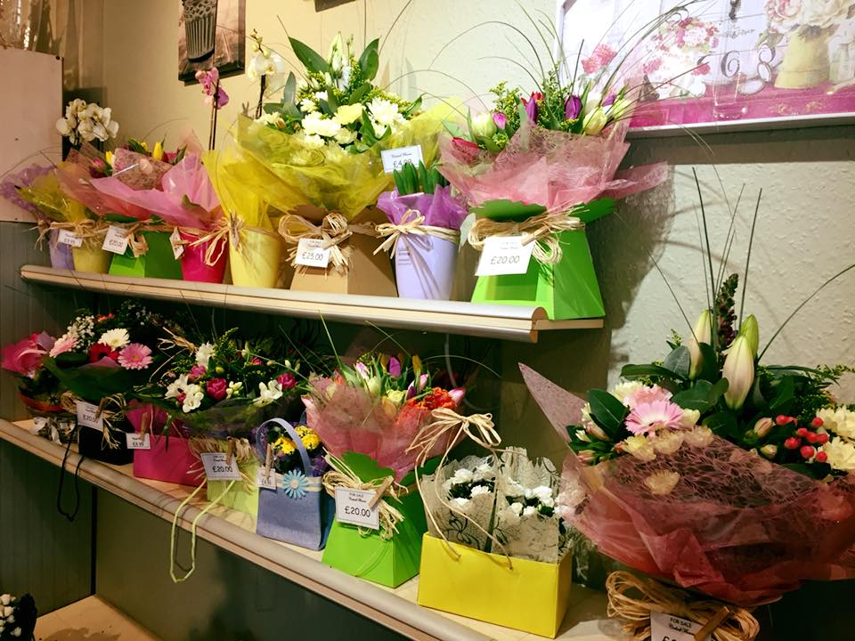 Colourful Flower Gift Boxes on Shelves