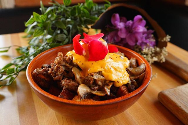 The Monki breakfast poutine is IN this Monday. Mushrooms, spiced ground beef, caramelized onions and cheese decorated with our signature proseco holly. 🐒🐒🐒 #breakfastpoutine #brunchsohard #monkibistro