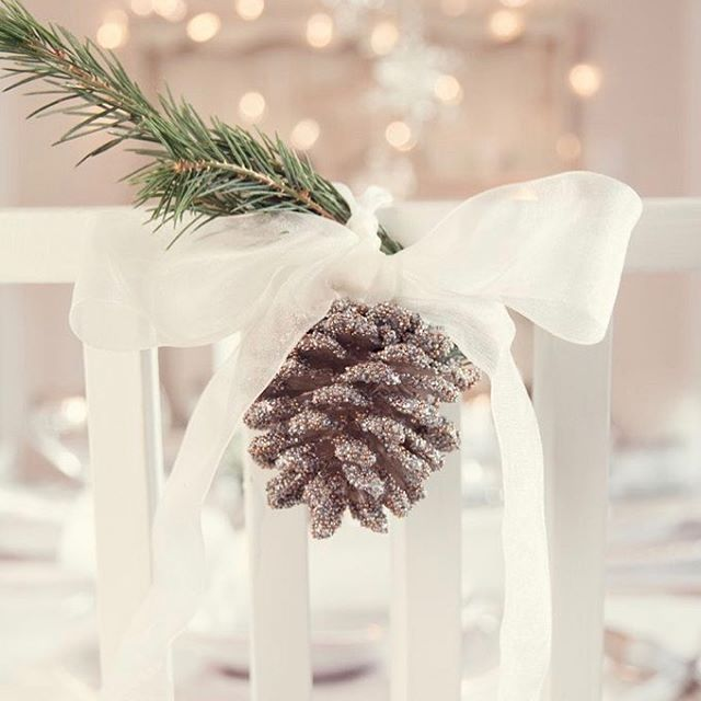 Weekly Wedding Inspo... we are feeling in that festive kinda mood. Add a little Christmas sparkle to your special day with this elegant chair decoration. Image from Pinterest. #christmaswedding #feelingfestive