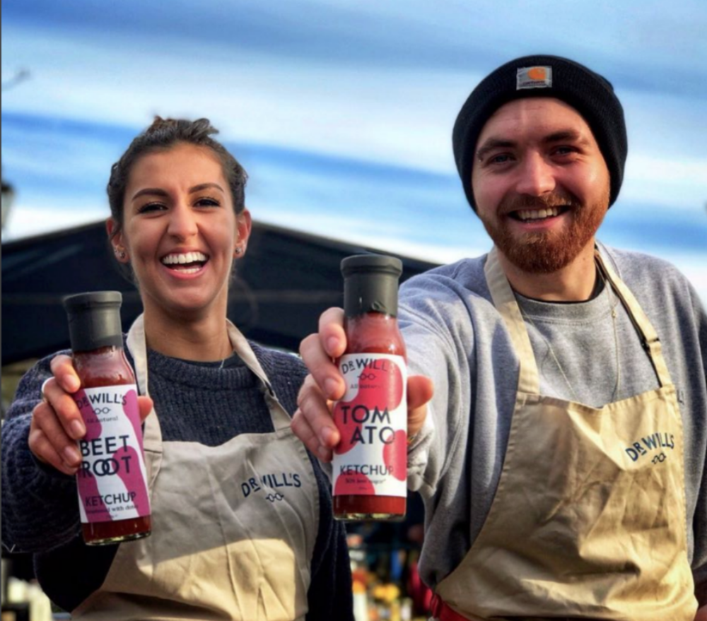Brand ambassadors selling beetroot ketchup and tomato ketchup in Dr Will's aprons