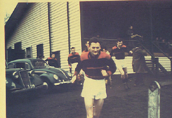1954 Best and Fairest Jack Greenaway leads the boys out on to Alphington field.
