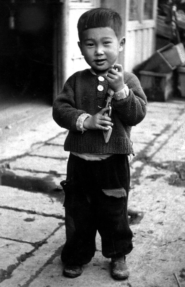 "27- ""And No Television Either"" Small Boy with Toy Gun, Ishinomaki"