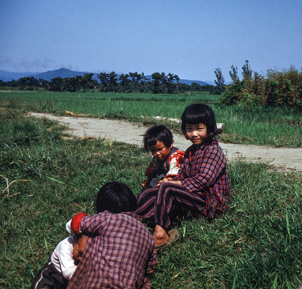 47-Three Children on bank of Canal
