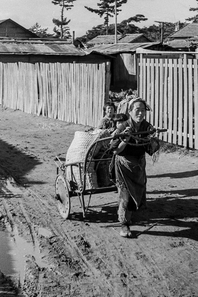 339-Woman Pulling Hand Cart with Small Child