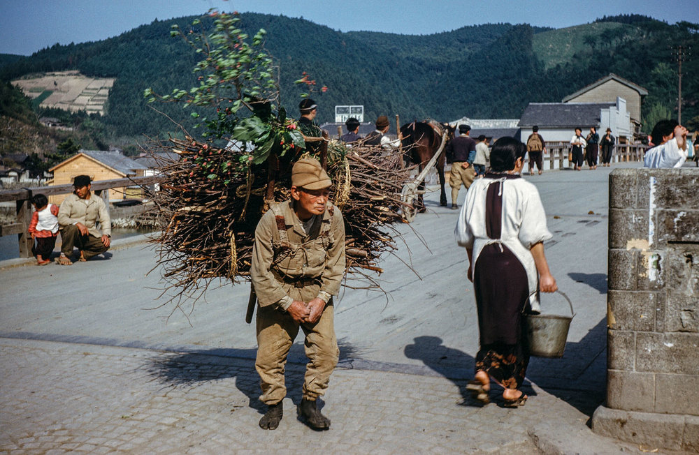 352-Man with Bundle of Sticks on Kyukitakami Bridge