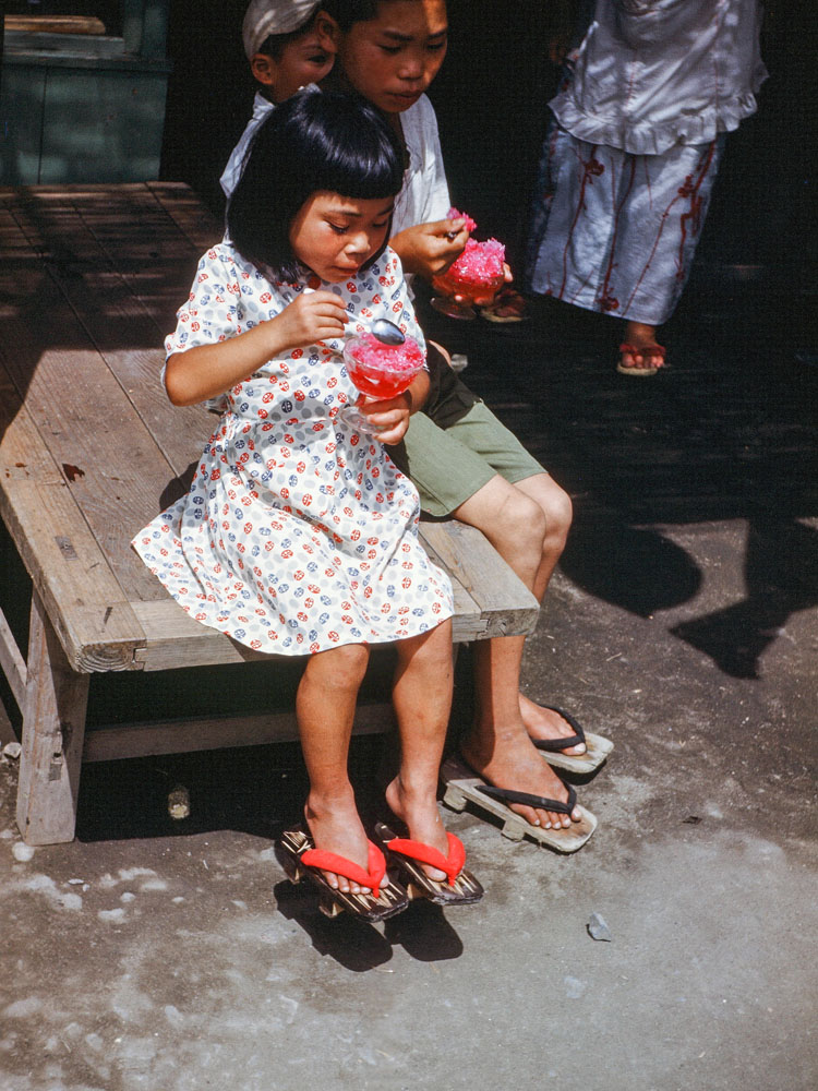 359-Young Girl Eating Shaved Ice