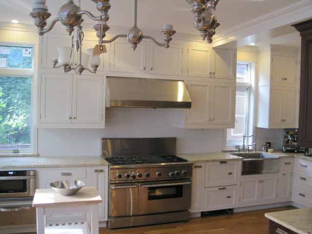 white-lacquered-maple-kitchen-cabinets-connecting-with-crown-moulding-that-wraps-the-entire-room-2.jpg