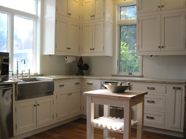 white-lacquered-maple-kitchen-cabinets-with-stainless-steel-knobs-and-handles-and-sink-11.jpg