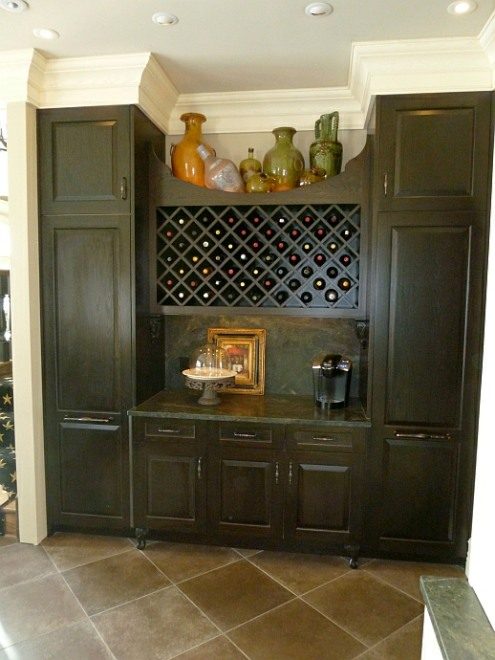 ebonized-white-oak-kitchen-cabinetry-with-marble-counter-and-wine-rack-8.jpg