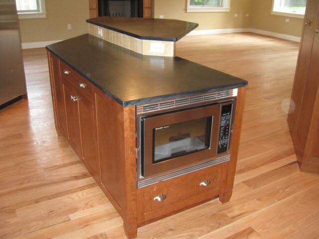 custom-solid-cherry-kitchen-island-with-black-granite-counter-top-and-oven-4.jpg
