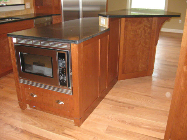 custom-solid-cherry-kitchen-island-with-black-granite-counter-top-and-oven-5.jpg