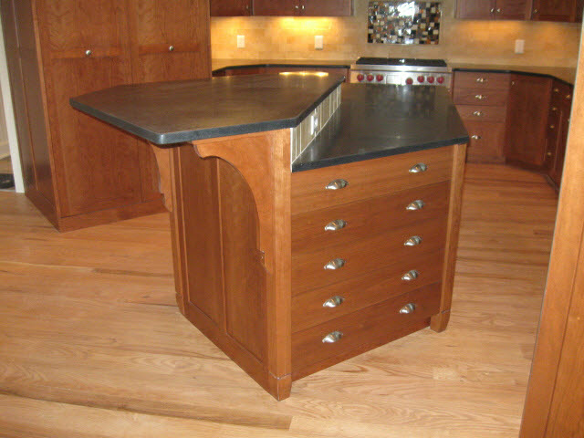 custom-solid-cherry-kitchen-island-with-black-granite-counter-top-with-two-counter-heights-and-utility-drawers.jpg