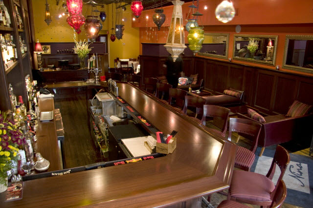 ninas-restaurant-bar-and-lounge-seating-area-done-in-quarter-sawn-sapelle-hard-wood-with-traditional-panel-moulding-7.jpg