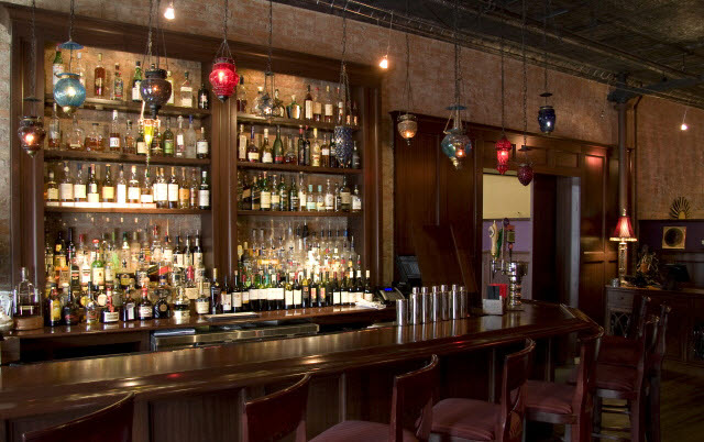 ninas-restaurant-bar-and-liquor-shelving-and-pocket-door-and-reception-desk-done-in-quarter-sawn-sapelle-hard-wood-traditional-panel-moulding-with-pocket-doors-13.jpg