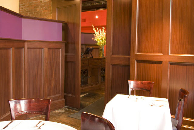 ninas-restaurant-done-in-quarter-sawn-sapelle-hard-wood-traditional-panel-moulding-with-pocket-doors-1.jpg
