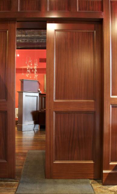 ninas-restaurant-done-in-quarter-sawn-sapelle-hard-wood-traditional-panel-moulding-with-pocket-doors-10.jpg