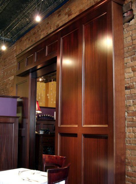 ninas-restaurant-done-in-quarter-sawn-sapelle-hard-wood-traditional-panel-moulding-with-pocket-doors-11.jpg