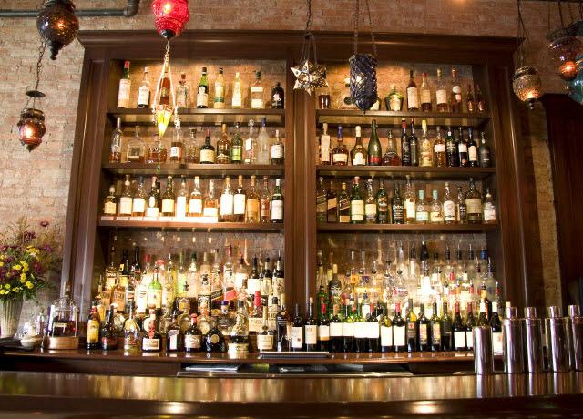 ninas-restaurant-liquor-shelving-done-in-quarter-sawn-sapelle-hard-wood-with-crown-moulding-2.jpg