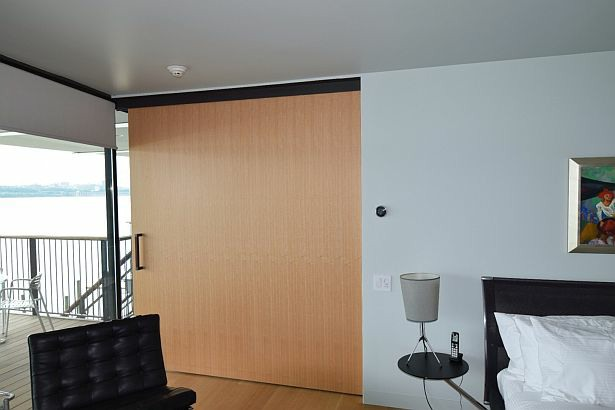Rift Anigre Wood pocket door in residence