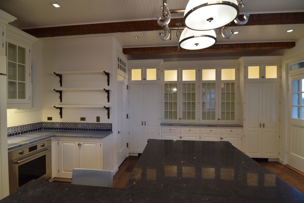 custom-white-lacquered-hard-maple-cabinets-with-inset-raised-panel-doors.jpg