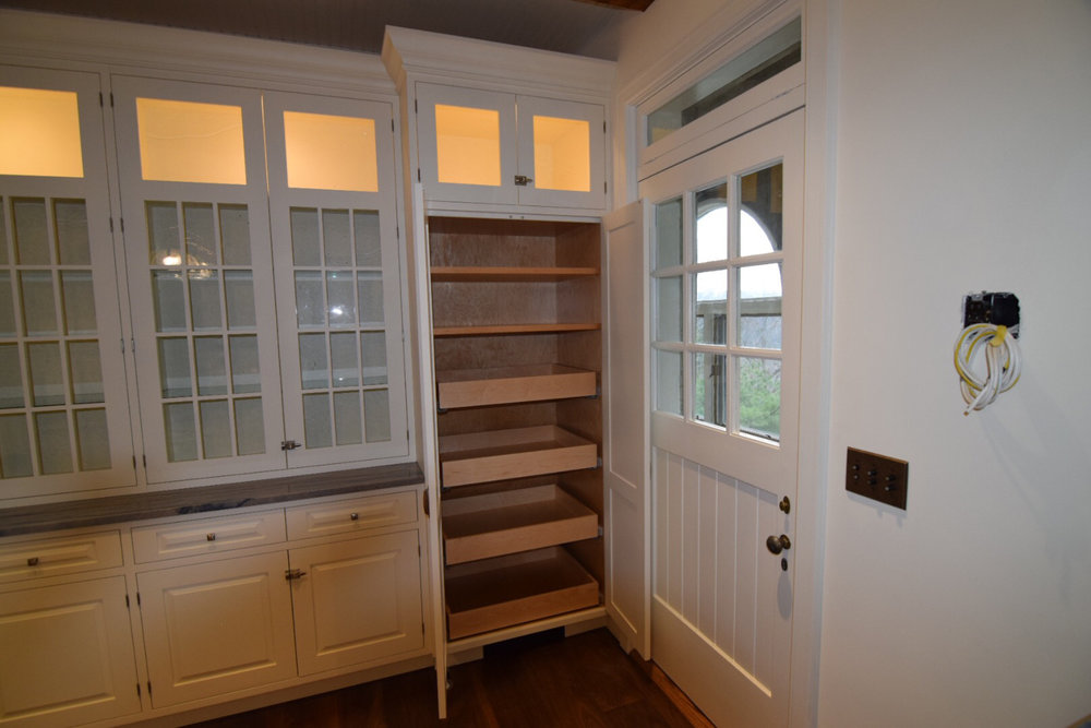 custom-pantry-cabinet-in-white-lacquered-kitchen-with-hard-maple-inset-raised-panel-doors.jpg