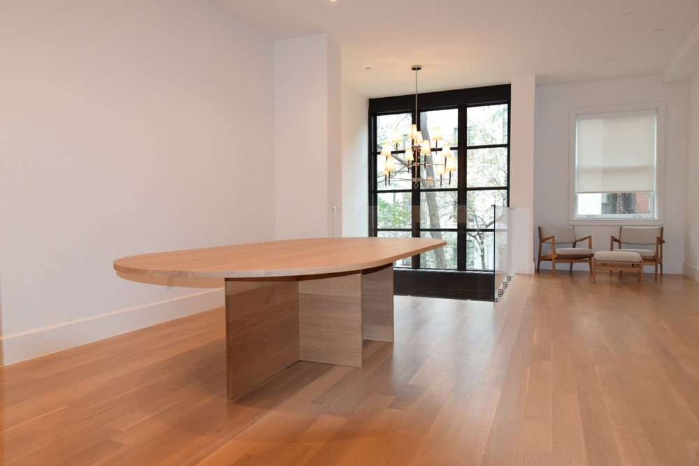 custom-oval-solid-white-oak-table-with-natural-oil-finish-1.25-inch-thick-and-10-feet-long-by-5-feet-wide.jpg