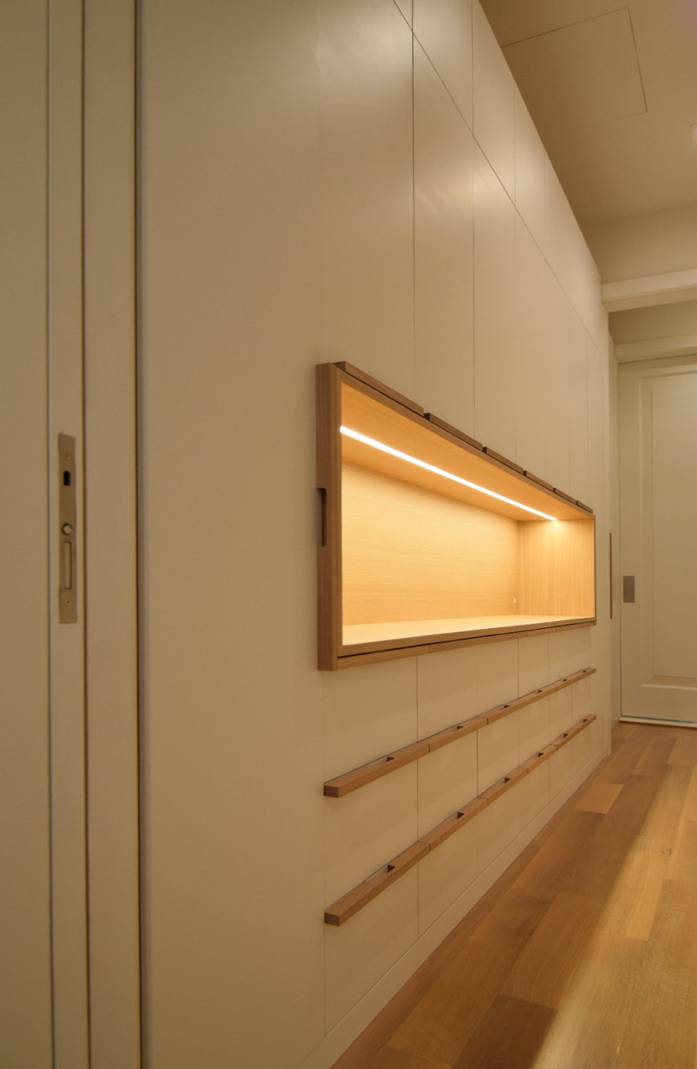 custom-walk-in-closet-drawers-white-lacquer-finish-maple-interior-white-oak-handles-and-white-oak-accent-open-cabinet.jpg