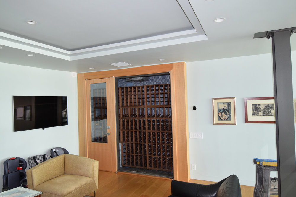 Custom Rift Anigre Wine Closet with Walnut Interior