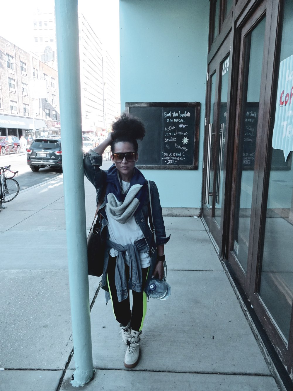 Artist Asia Monique pictured outside of Next Door Cafe wearing local brands: Anna Hovet convertible tank to snood/Rae Christine Sunglasses/Iridium patchwork throwback denim