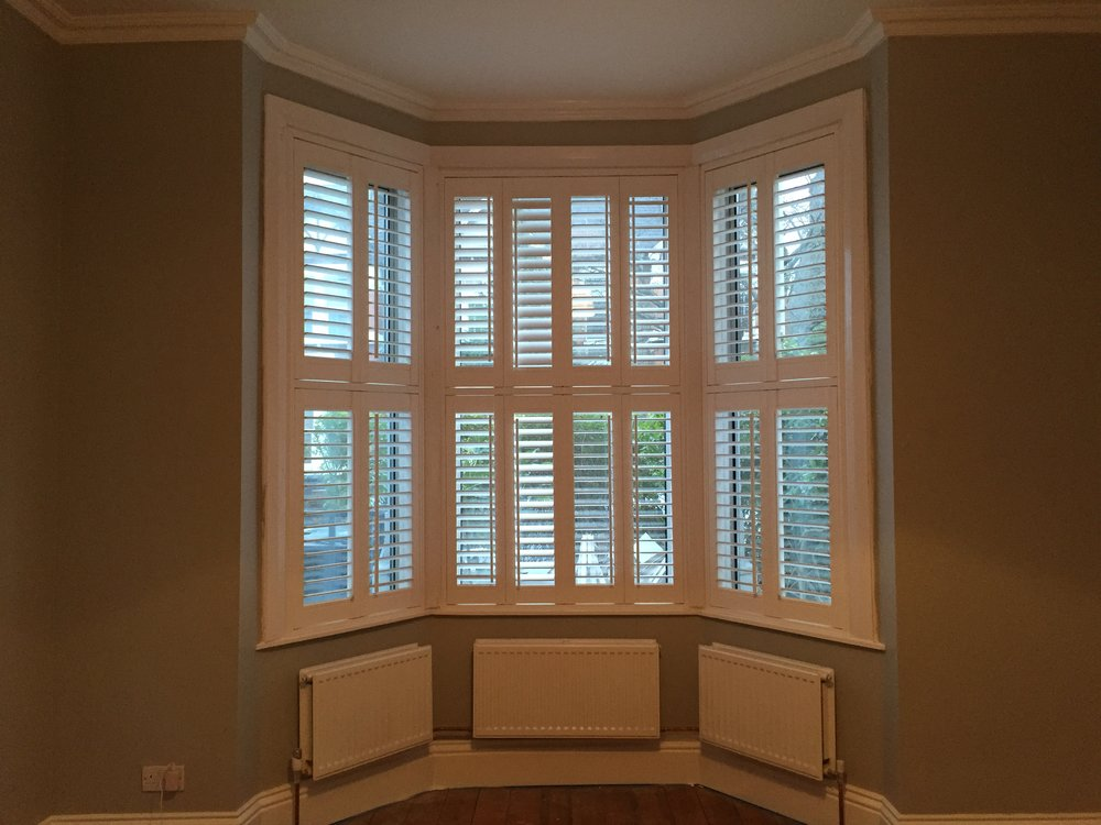 Radiators across bay window