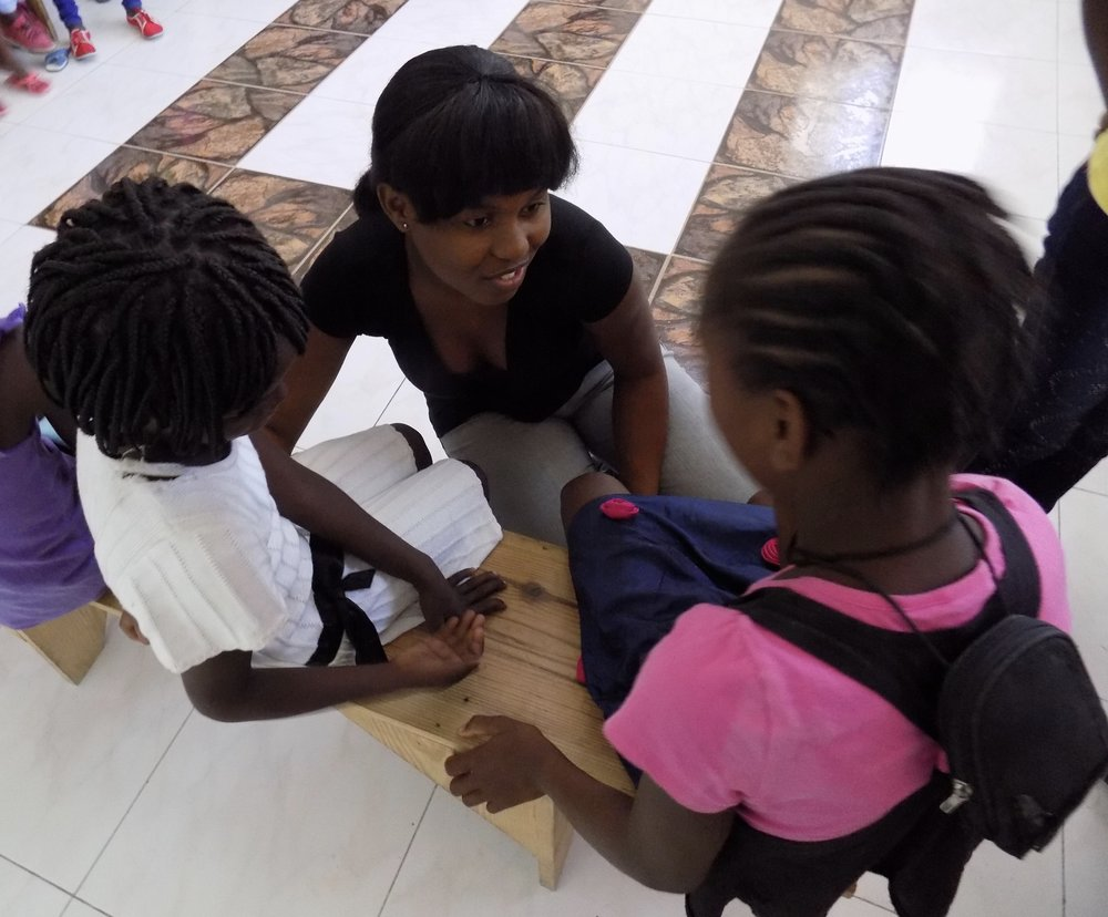 Nishina Previlon, an education major at Quisqueyah University and a H.E.L.P. scholar taught in our summer camp during her first internship, and then returned 1 year later as an assistant coordinator for a summer. Nishina hopes to use her education and experience to improve the future of education in Haiti.