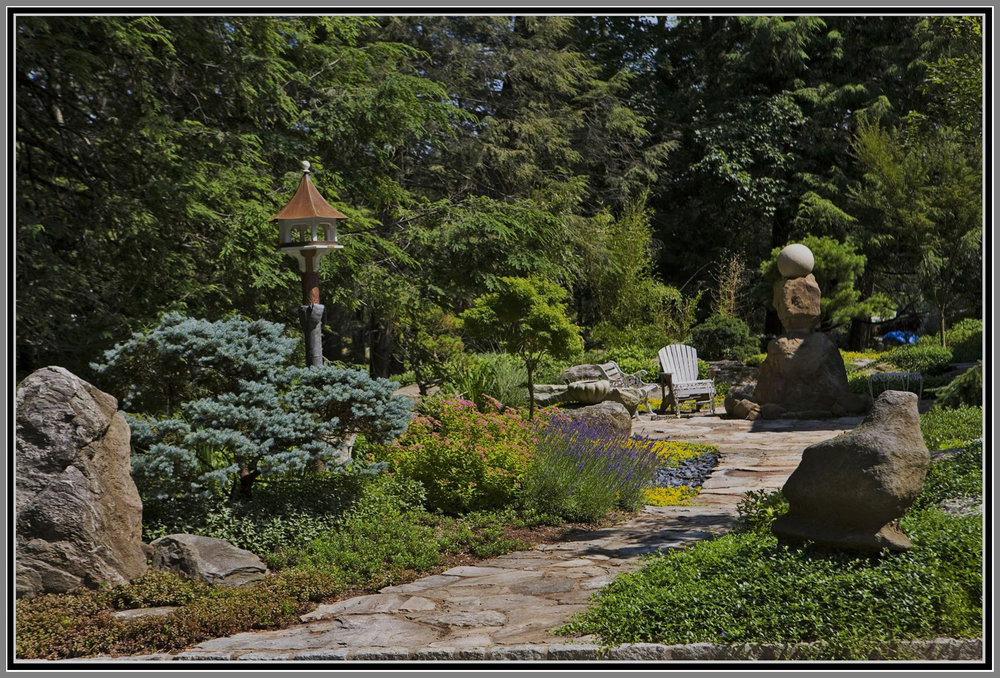 Flag stone walkway with beautiful garden and ornaments