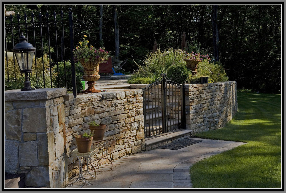 Stone wall pool fence with gate