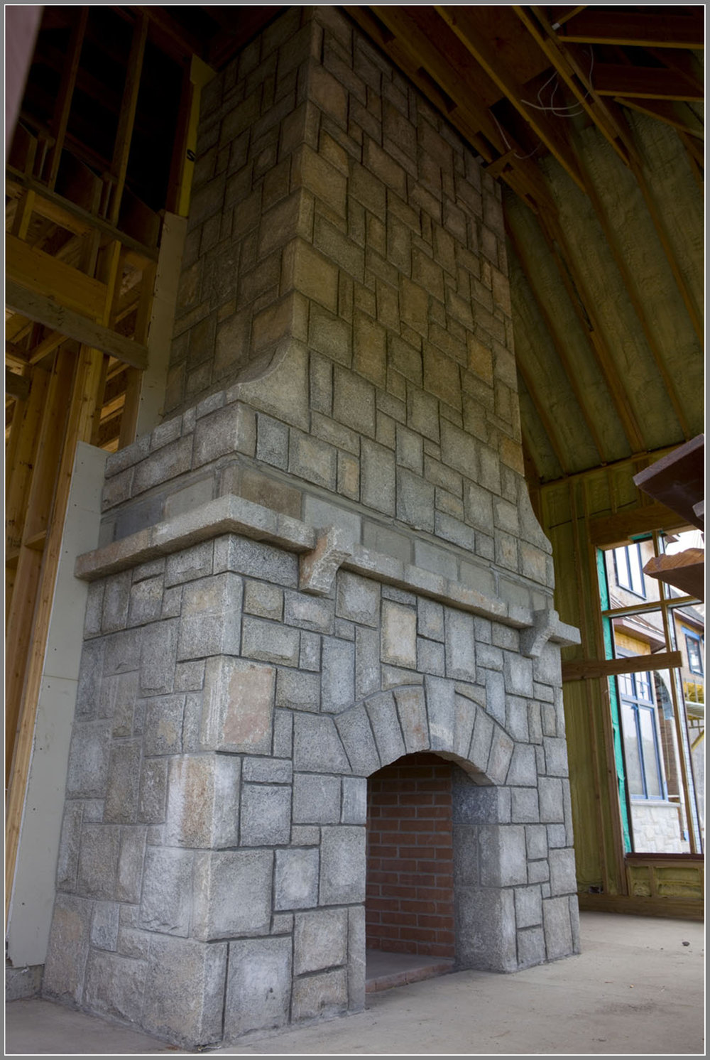 Granite stone fireplace by Artistic Outdoors