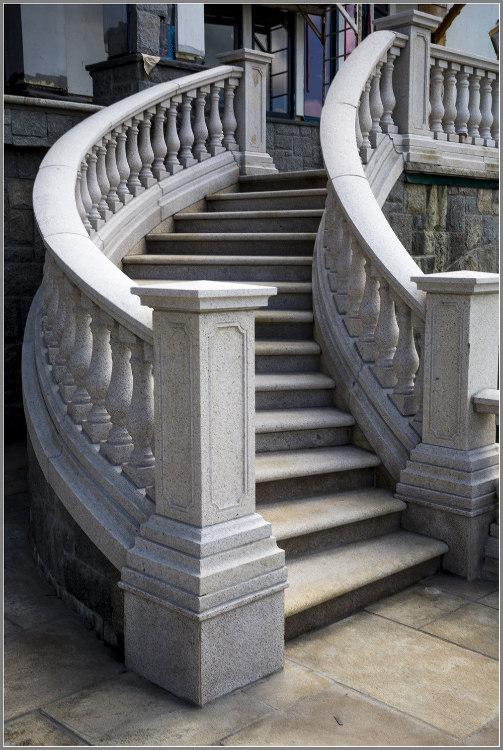 Curved granite balustrade stair system